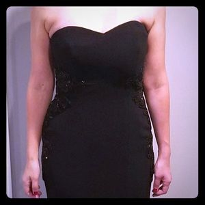 Black strapless dress with sequence and train